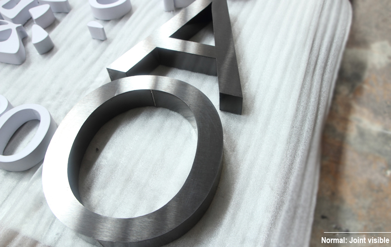 normal-Metal-Letter-Logo