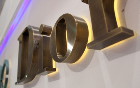 Bronze Reverse Lit Metal Acrylic Channel Letter Sign